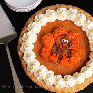 top a pumpkin pie with sugar coated pie crust decorated like a cute turkey
