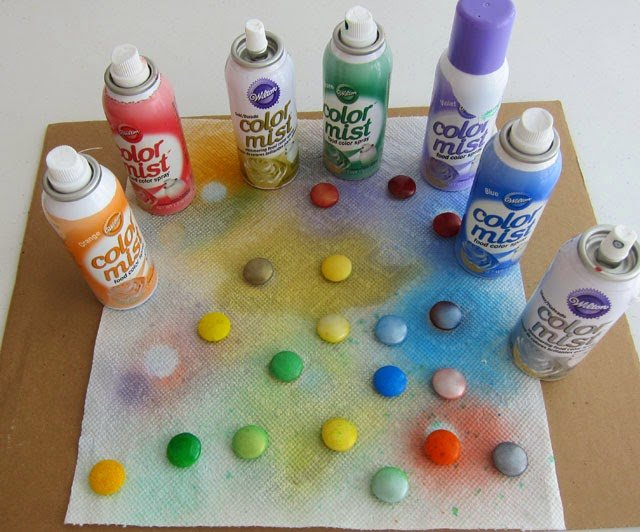 Spray Color Mist over Mega M&M's to make shimmering candy oranaments | HungryHappenings.com