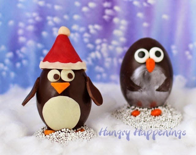 Two ways to decorate Chocolate Penguin Truffles with White Chocolate Amaretto Raisin Ganache http://www.hungryhappenings.com