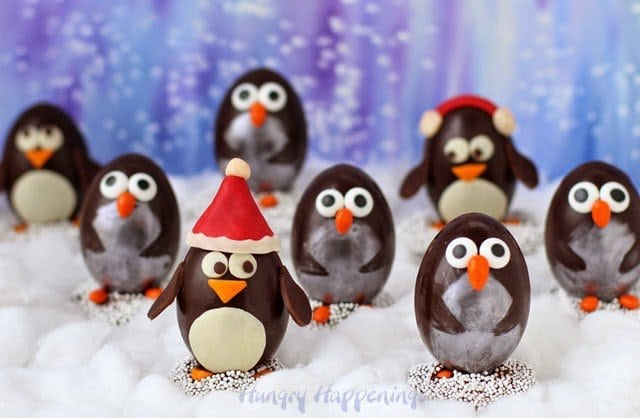 A whole colony of Chocolate Penguin Truffles with White Chocolate Amaretto Raisin Ganache http://www.hungryhappenings.com