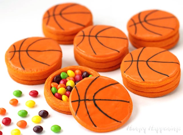 candy filled basketball cookies with Skittles on the table next to the cookies