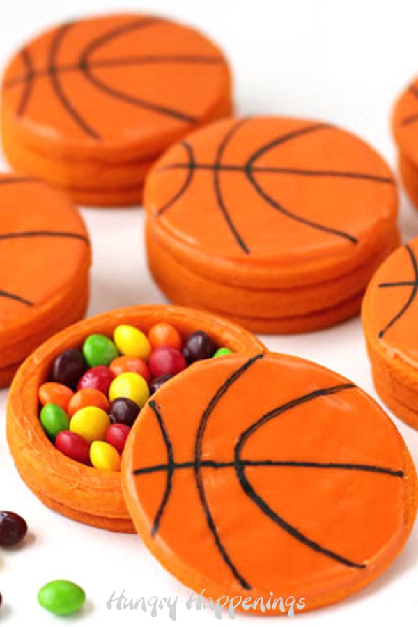 Crack open a basketball piñata cookie to find Skittles candy hiding inside. These treats are perfect for a basketball-themed party or March Madness event.