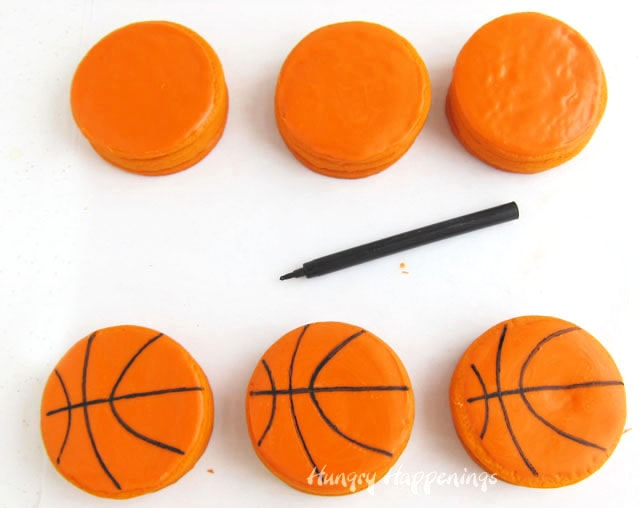 use a black food color marker to draw lines onto basketball cookies