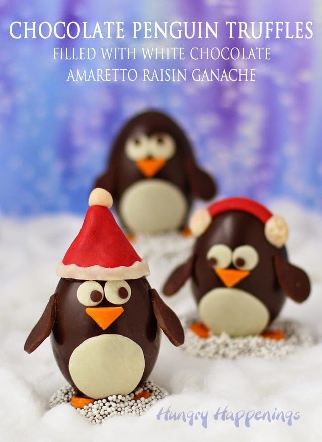 Chocolate Penguin Truffles with White Chocolate Amaretto Raisin Ganache decorated two ways. Stop by to check out the easy version too. http://www.hungryhappenings.com