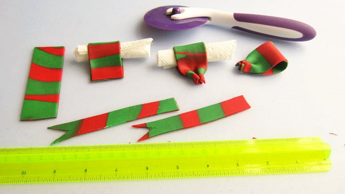 Make a fondant bow using the red and green striped fondant.