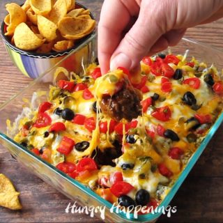 Hot taco dip is an easy appetizer to make for a New Year's Eve party, a Super Bowl party, or just about any party.