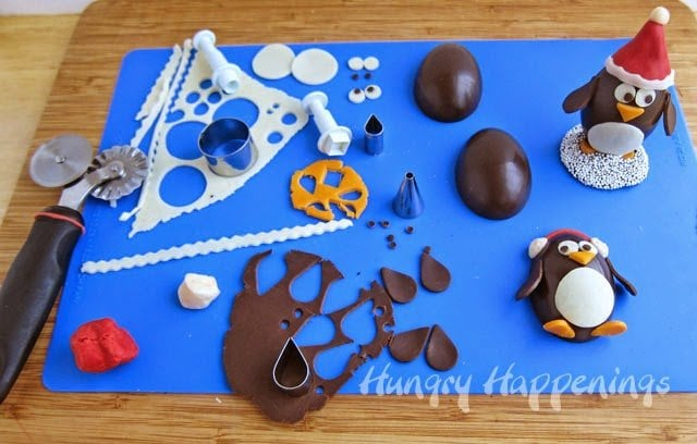 How to decorate Chocolate Penguin Truffles using modeling chocolate | http://www.hungryhappenings.com