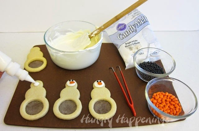 How to make Snowflake Filled Snowman Cookies decorated with Candy Melts