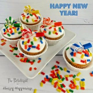 New Year's Confetti Cupcakes with Party Horns to Celebrate New Year's Eve