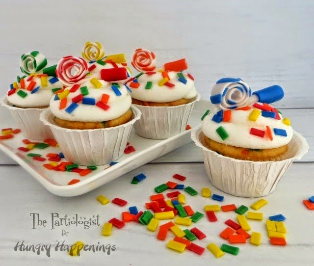 Confetti Cupcakes topped with Party Horns for New Year's Eve Celebrations by The Partiologist for HungryHappenings.com