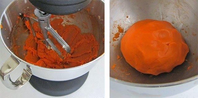 orange cookie dough in a KitchenAid mixer