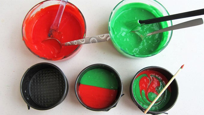 Fill half of three 4-inch round springform pans with red cake batter and half with green batter. Use a skewer to swirl the colors together.