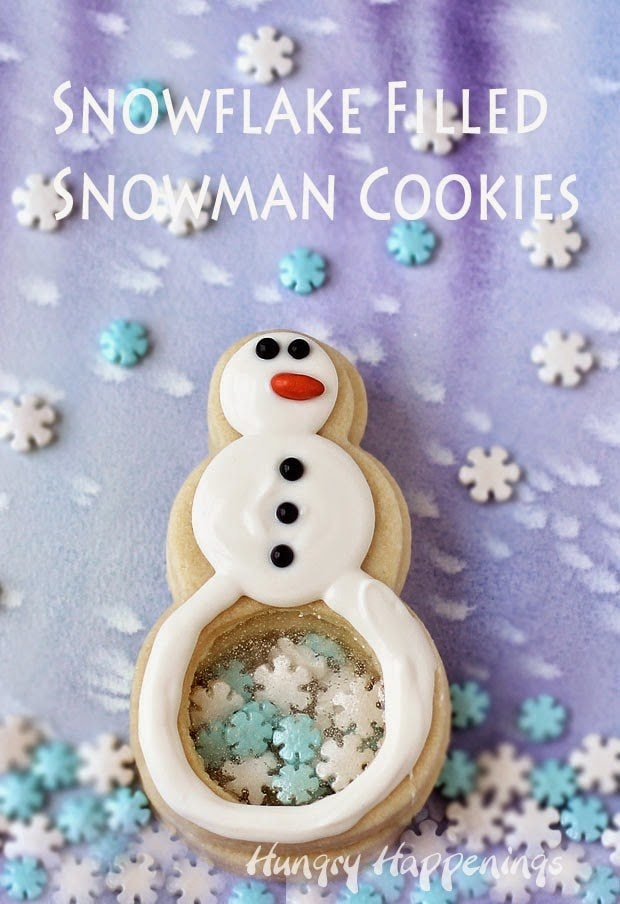 Build your own sweet snowmen in the warmth of your kitchen. These Snowflake Filled Snowman Cookies are made by stacking three cookies together. Each snowman has a clear candy belly so you can see the candy snowflakes inside.