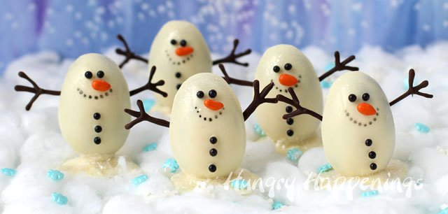 This winter warm up in the kitchen with some Snowmen Truffles filled with Chocolate Hazelnut Coffee Ganache. They are so darn cute!