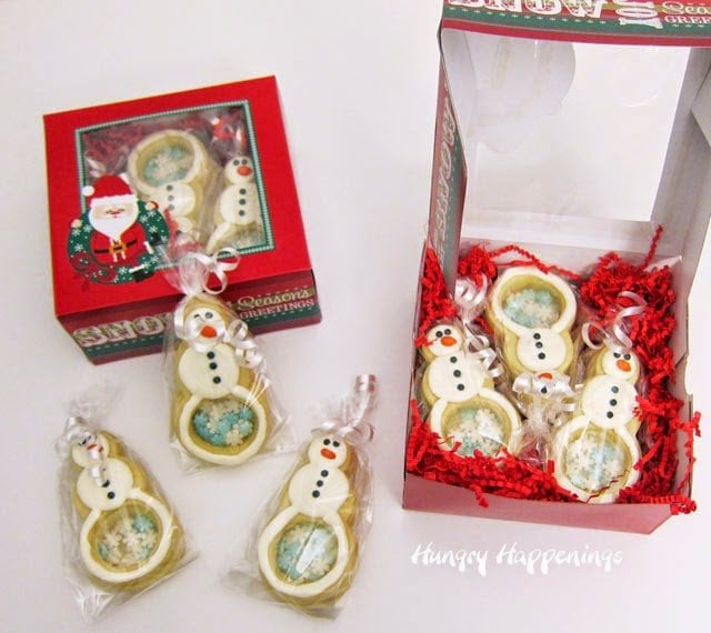 Snowman Cookies with Candy Bellies filled with Snowflakes | http://www.hungryhappenings.com
