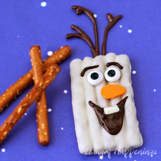 It was so fun seeing all the enthusiasm shown for my Chocolate Pretzel Snowman Craft yesterday and I'm super excited to share these Chocolate Olaf Pretzel Craft with you today. I hope you like them as much as the original.