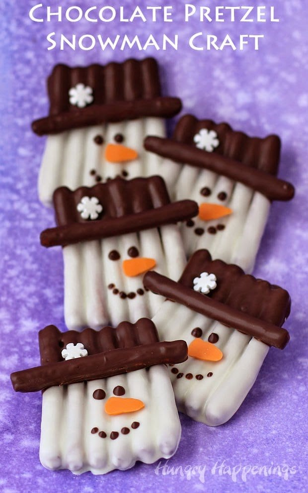 Chocolate Pretzel Snowman Craft - This winter, get crafty in the kitchen by making some sweet and salty snowmen pretzels. Each pretzel snowman couldn't be cuter with their orange carrot noses, snowflake topped hats, and sweet smiles.