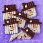 Turn dipping pretzels into these adorable Chocolate Snowman Pretzel Crafts. They make super cute holiday gifts.