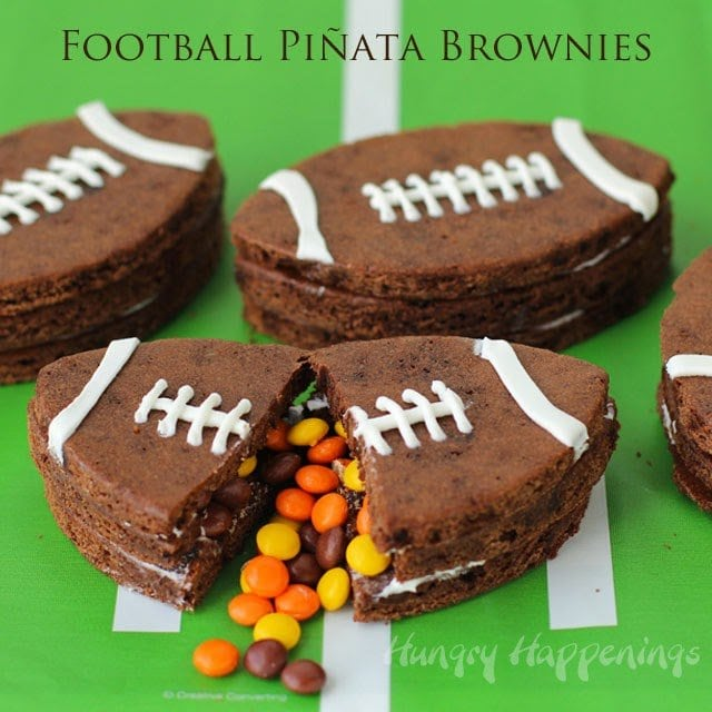 Making candy filled piñata cookies is so fun and today I've added a twist. I used brownie batter instead of cookie dough to make Football Piñata Brownies filled with mini Reese's Pieces.