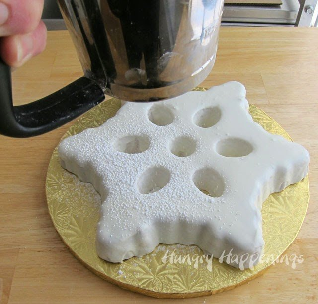 Glazes Snowflake Cake with Powdered Sugar on Top