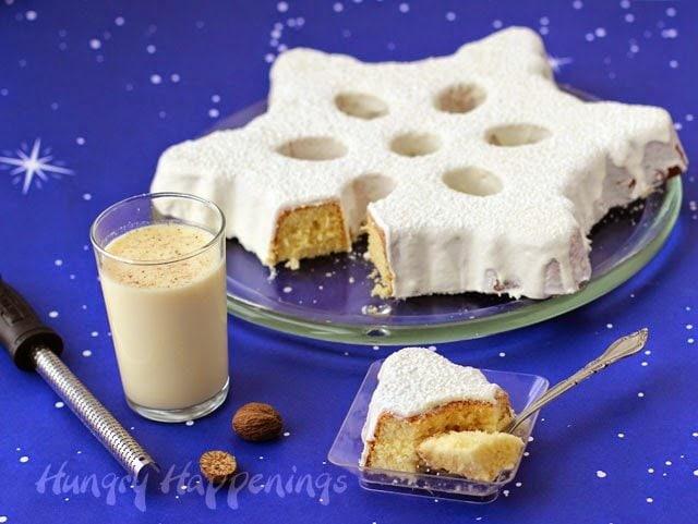 A simple wintertime dessert bursting with eggnog flavor. Eggnog Snowflake Cake Topped with Eggnog Ganache by HungryHappenings.com