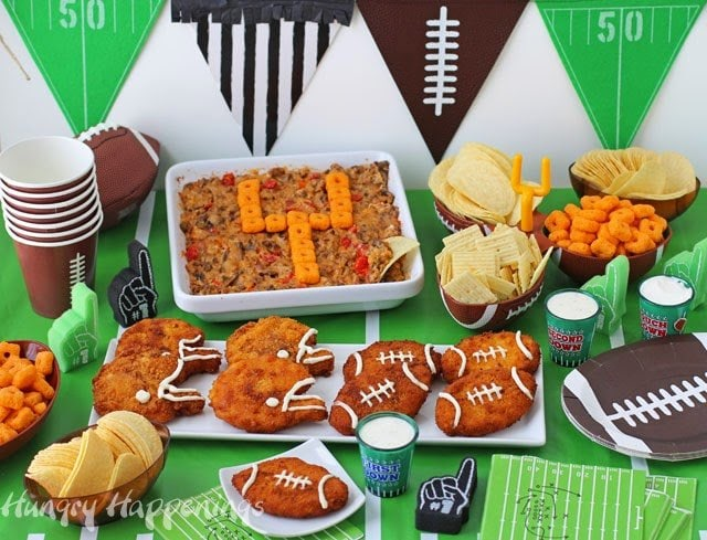 Get your party on with these Football and Helmet Chicken Nuggets & Decorated Dip. Perfect for a Super Bowl or tailgating party. From HungryHappenings.com