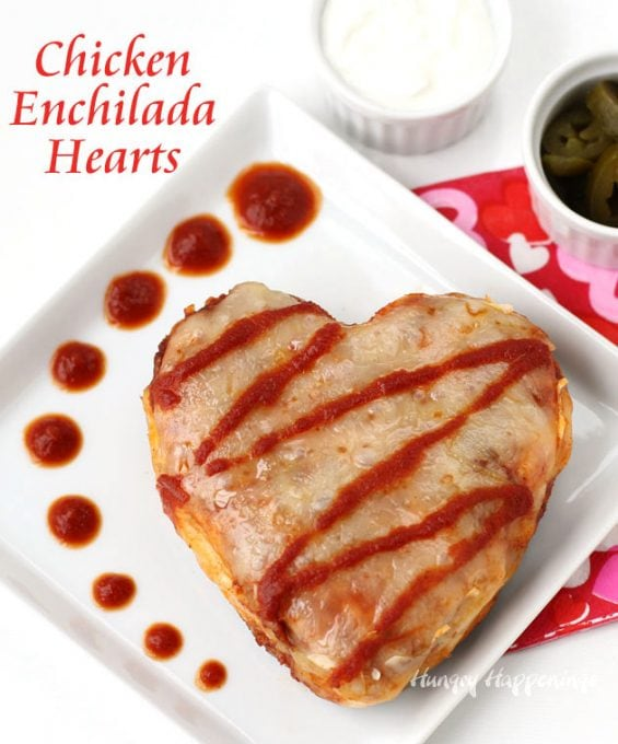 Create a festive heart-shaped dinner for Valentine's Day! These Chicken Enchilada Hearts are easy to make using a heart shaped pan and can be as spicy as you like.