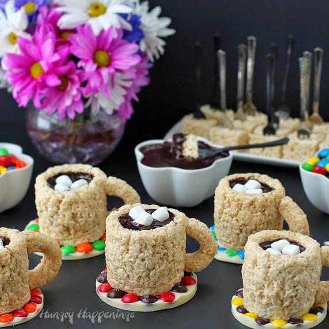 I hosted a Krispies Kreations party for a few friends last month and surprised them with these Cafe Mocha Rice Krispie Treat Cups! They are adorable and delicious, the best of both worlds!