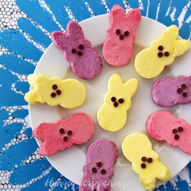 Sweeten up some Cheesecake Peeps with brightly colored raspberry, blueberry or lemon puree to make a cute Easter dessert. Recipe from HungryHappeings.com