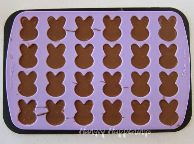 Use a Wilton silicone bunny mold to create super simple Reese's Fudge Easter Bunnies.
