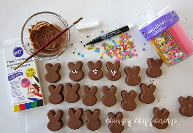Decorate chocolate peanut butter fudge Easter bunnies with cute smiles and pink noses.