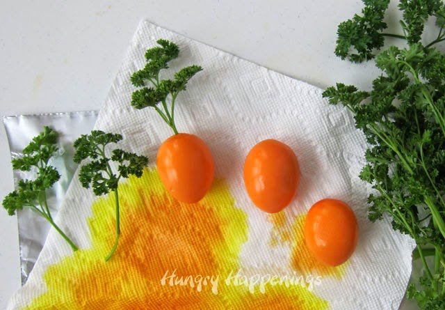 How to die hard boiled eggs orange and decorate them to look like carrots. Tutorial at HungryHappenings.com