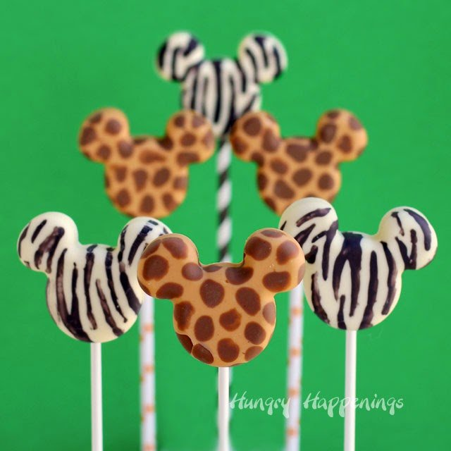 Use a simple painting technique in silicone candy molds to create these Animal Print Mickey Mouse Pops. Tutorial at HungryHappenings.com
