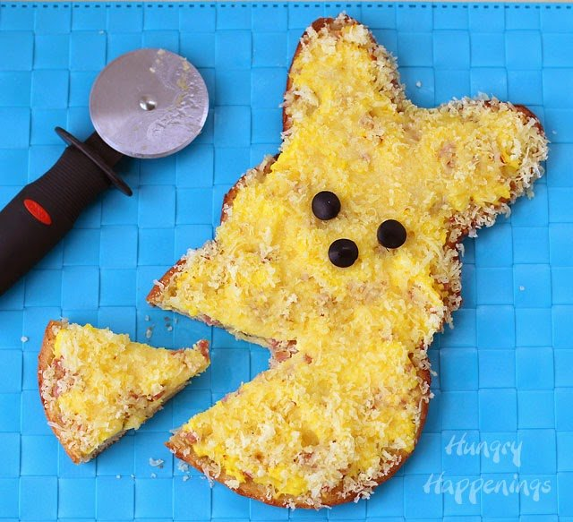 Want a fun dish to serve at Easter brunch? Make some cute Egg, Ham and Cheese Breakfast Pizza Peeps. See recipe at HungryHappenings.com