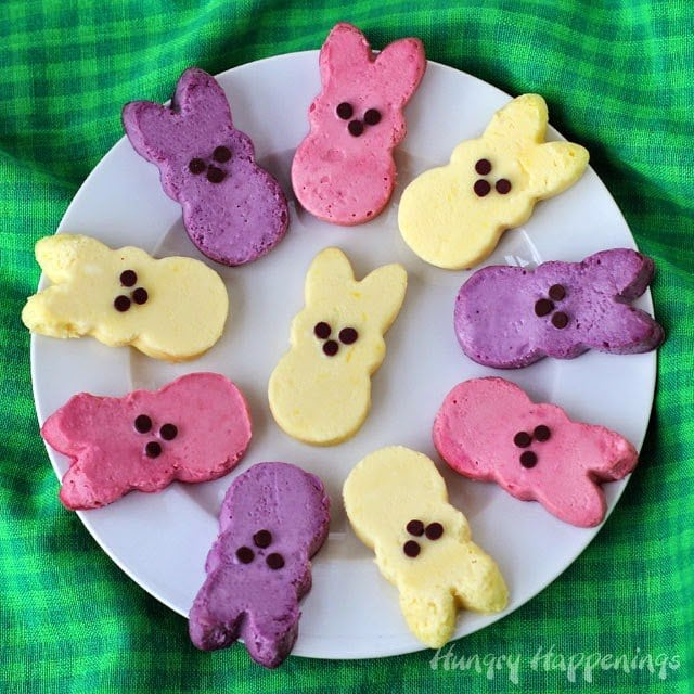 These Naturally Colored Raspberry, Blueberry and Lemon Cheesecake Peeps will brighten up any Easter dessert table. Recipe from HungryHappenings.com