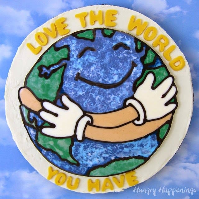 "Learn how to use a coloring page to create a chocolate ""Love the World"" topper for an Earth Day dessert. Tutorial at HungryHappenings.com"