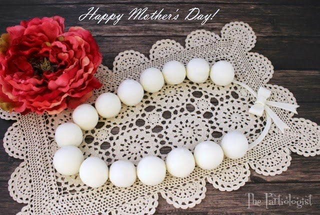It's Kim, The Partiologist and today I'm back with a sweet strand of Edible Pearls for Mother's Day. It's been awhile since I've been here at Hungry Happenings but I can't wait for you to try this amazing recipe, all the moms in your family are going to love this!