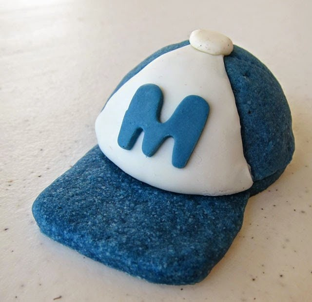 How to make 3-D Baseball Cap Cookies. Instructions at HungryHappenings.com