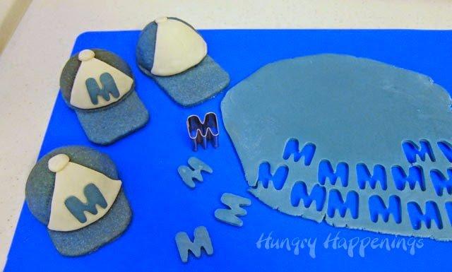 How to make 3-D Baseball Cap Pinata Cookies. Instructions at HungryHappenings.com