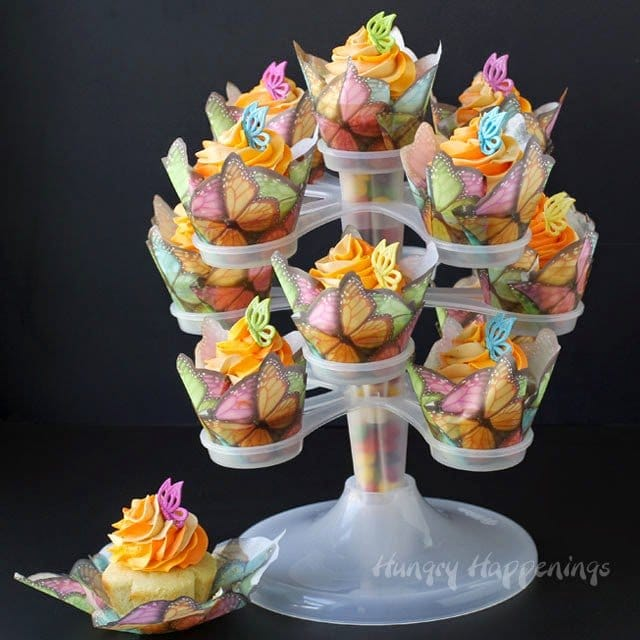 Pretty Peach Cobbler Cupcakes decorated with butterflies are sure to make your mom's heart soar this Mother's Day