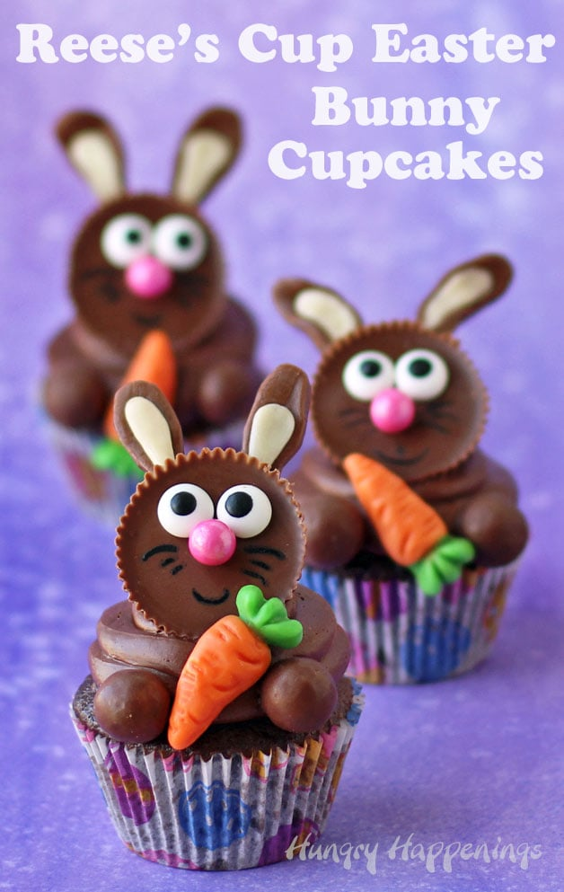 Easter bunny cupcakes - three cupcakes topped with Reese's Cup Bunnies each holding a gummy carrot