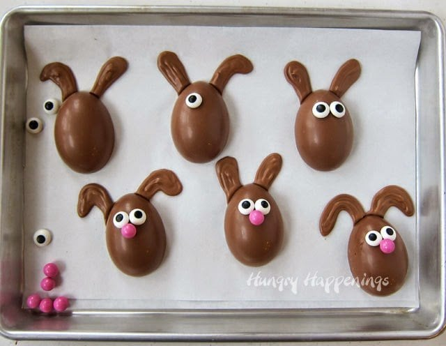 Handmade peanut butter fudge filled chocolate Easter eggs can be decorated to look like bunnies.
