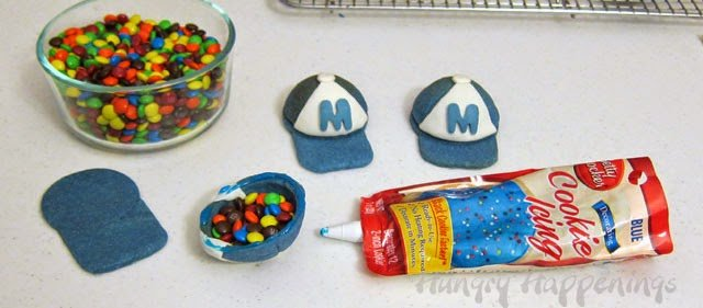 How to make Candy Filled 3-D Baseball Cap Pinata Cookies. Instructions at HungryHappenings.com