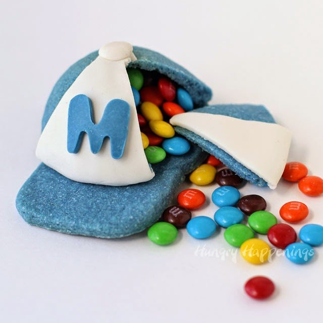 You'll hit a home run with your favorite ball players when you make them a batch of Candy Filled Baseball Cap Pinata Cookies. They're fun to make and even more fun to eat!