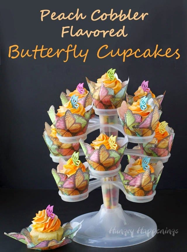 Peach Cobbler Butterfly Cupcakes baked in colorful cupcake wrappers will make your mom's heart soar this Mother's Day. Recipe from HungryHappenings.com