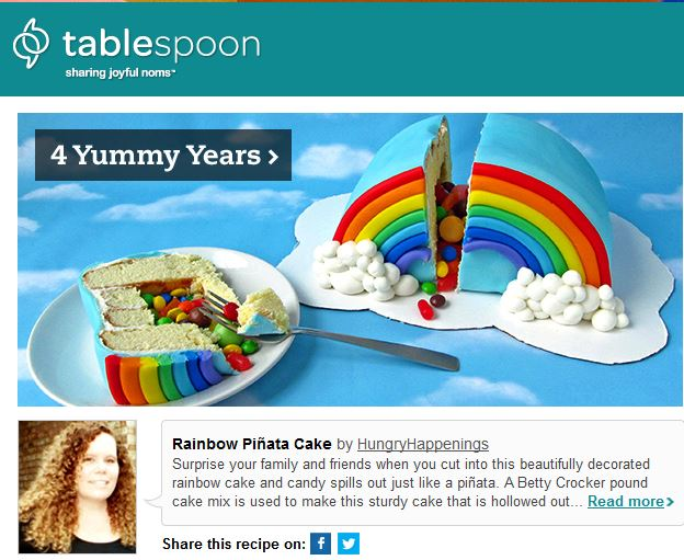 Rainbow Pinata Cake featured on Tablespoon.com