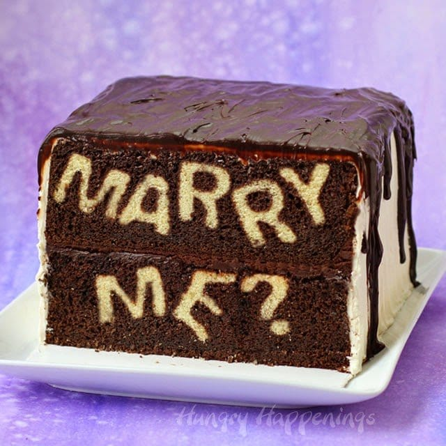 If you are looking for a unique way to propose, serve this Marry Me? Reveal Cake and watch with anticipation as the love of your life cuts into the cake and answers your question. You'll find the instructions to make this cake at HungryHappenings.com