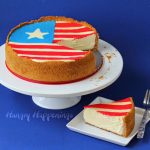 American flag cheesecake with a slice cut out.