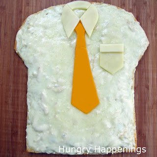 A fun way to serve pizza for Father's Day. Shirt and Tie Pizza recipe at HungryHappenings.com