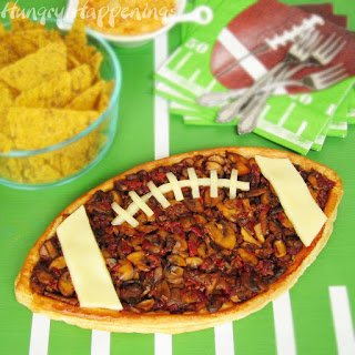 Score Big with Dad this Father's Day by serving him a football shaped tart for dinner. Recipe at HungryHappenings.com